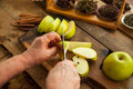 Woman slicing apples with knife for cooking pie. Royalty Free Stock Photo