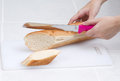 Woman slicing bread Royalty Free Stock Photos