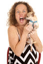 Woman small dog chevron dress mouth open an older with a funny expression holding on to her Stock Photography