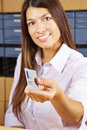 Woman with smart card at reception happy young a Royalty Free Stock Image