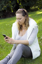 Woman with smart phone outdoors