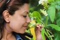 Woman smell a flower in green garden paris Royalty Free Stock Photos