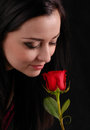 Woman smell a rose Stock Images