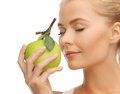Woman smelling apple beautiful young fresh green Stock Photos