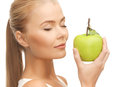 Woman smelling apple beautiful young fresh green Royalty Free Stock Photography