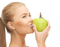 Woman smelling apple beautiful young fresh green Royalty Free Stock Photo