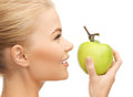 Woman smelling apple beautiful young fresh green Royalty Free Stock Photos