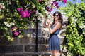 Woman smelling bougainvillea tropic flower beautiful in a garden Stock Images