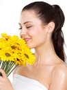 Woman smelling flowers Stock Images