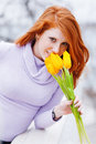 Woman smelling flowers Royalty Free Stock Photos