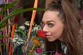 Woman smelling flowers beautiful young Stock Photo