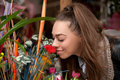 Woman smelling flowers beautiful young Royalty Free Stock Photography