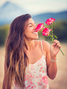 Woman smelling flowers in nature young Stock Photos