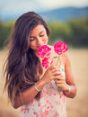 Woman smelling flowers in nature young Stock Images