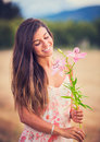 Woman smelling flowers in nature young Royalty Free Stock Photos