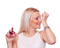 Woman smelling perfume on her hand Stock Photography