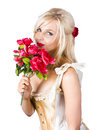 Woman smelling red flowers portrait of fashionable young blond bouquet of white background Royalty Free Stock Image
