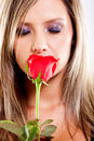 Woman smelling a rose Royalty Free Stock Photography