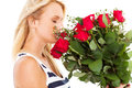 Woman smelling roses Stock Image