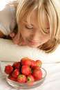 Woman smelling strawberries Royalty Free Stock Photography