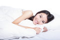Woman smile face close up lying on the bed Royalty Free Stock Images