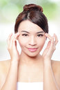 Woman smile face and finger point to eyes beautiful concept for eye skin care isolated over nature green background asian Royalty Free Stock Photography