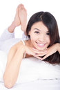 Woman smile face while lying on the bed Royalty Free Stock Photo
