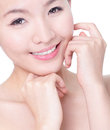Woman Smile and hand touch her face Stock Photos
