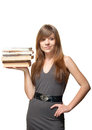 Woman smiles and holds a stack of books Royalty Free Stock Images