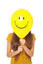 Woman with smiley face balloon Royalty Free Stock Photo