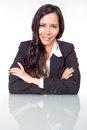 Woman smiling administrative with arms crossed Royalty Free Stock Images