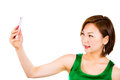 Woman smiling being happy taking picture of herself using mobile phone beautiful Stock Photography