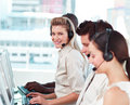 Woman smiling at camera in a call centre Royalty Free Stock Image