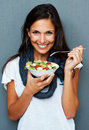 Woman smiling while holding bowl of salad Stock Image