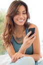 Woman Smiling And Holding Mobile Phone Royalty Free Stock Images