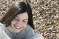 Woman smiling while looking away at beach closeup of beautiful young Royalty Free Stock Images
