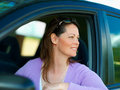 Woman smiling through opened car window Royalty Free Stock Images
