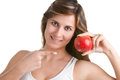 Woman smiling pointing red apple holds her hand Royalty Free Stock Photography