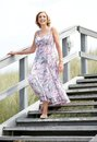 Woman smiling and walking downstairs outdoors Royalty Free Stock Photo