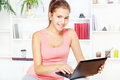 Woman smiling while working on laptop Stock Photos