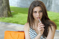 Woman smokes electronic cigarette. Royalty Free Stock Photo