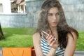 Woman smokes electronic cigarette. Royalty Free Stock Photo