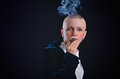 Woman smoking bald young cigar in studio Stock Photos