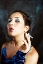 Woman smoking a cigarette Royalty Free Stock Photo