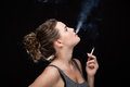 Woman smoking concept on black Royalty Free Stock Photo