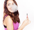 Woman smoking e cigarette fag wearing purple dress Royalty Free Stock Photos