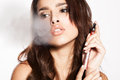 Woman smoking e cigarette with the smoke on the side Royalty Free Stock Photo