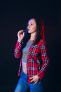 Woman smoking electronic cigarette with smoke Royalty Free Stock Photo