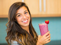 Woman with smoothie drinking fresh fruit Royalty Free Stock Images
