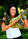 A woman with snake Stock Image